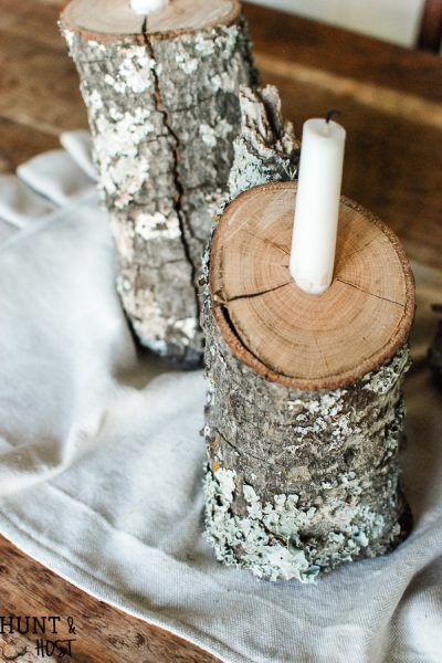This easy DIY tutorial will show you how to take tossed firewood and turn it into a beautiful rustic winter tablescape by creating log candlesticks.