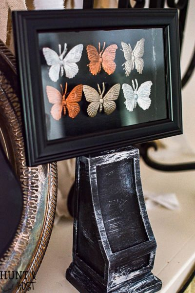 Halloween decorating ideas from the dollar store. These gilded bugs display cases are glamorous and easy to make Halloween décor.