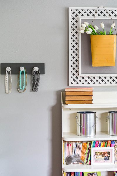 This easy scrap wood coat rack is perfect to organize headbands, belts, jewelry, dish towels or whatever else you need to wrangle! It's an easy weekend project!