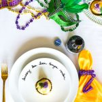 "A classic Mardi Gras table and traditions full of New Orleans flair. An easy DIY plate decoration, ""laissez les temps rouler"" No Mardi Gras party is complete without king cake and café du monde coffee. Get your Mardi Gras beads and doubloons out for this festive big parade party!"