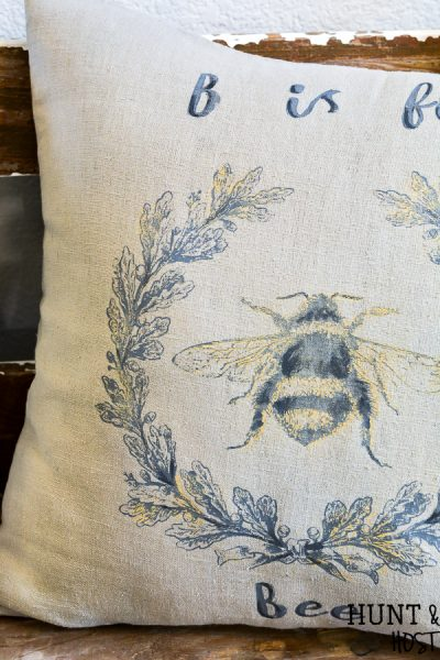 This stunning DIY Bee pillow is perfect for a teacher gift or your classic decorative pillow stash. Quick and easy to make with stencils from a Maker's Studio Chalk Art collection. Complete with a list of the products you need to make your own DIY bee pillow cover!