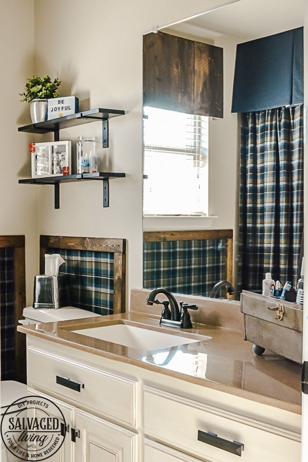 Decorating ideas for a small rustic bathroom. Perfect for a bunch ob boys and a casual cabin bathroom decor. With easy DIY open shelving and faux wall panels, there are some great bathroom decorating ideas here. #rusticbathroom #smallspaceideas #boysbathroom #fauxwallpaper #openshelving #shelfbrackets #DIYstorage #plaidwalls #rusticbathroomcolors #simpleideas