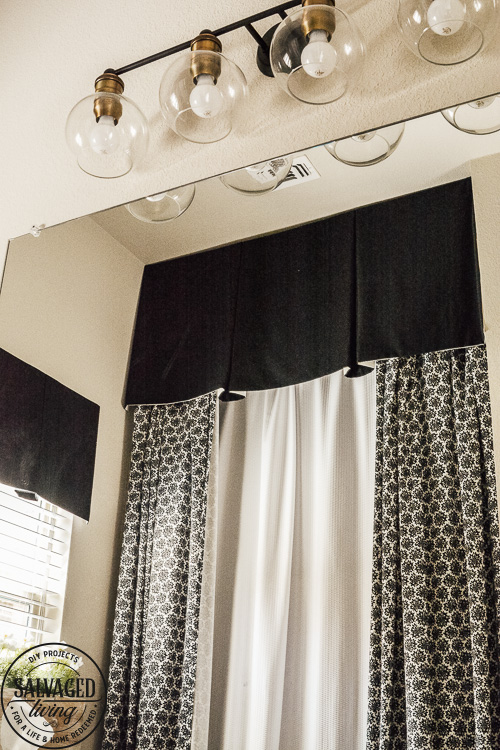 Steal some cozy black and white bathroom ideas to decorate you bathroom into a haven! The floor to ceiling shower curtain treatment and indoor window flower box are fabulous! #blackandwhitedecor #blackandwhitebathroom #teenbathroom #cozybathroomidea #showercurtainideas #DIYwindowbox #indoorwindowbox #tweengirldecorating