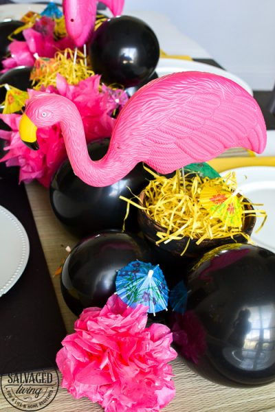 Good, cheap table decor for summer from the dollar store! Nothing beats a cute flamingo centerpiece and dollar store decor accents for an inexpensive kickoff to the summertime. See these creative DIY summer table ideas come to life from the 99 Cent Only Store! #dollartree #dollarstore #summertablescapes #summercenterpieces #simplesummer #flamingodecor #dollartreediy #flamingoparty