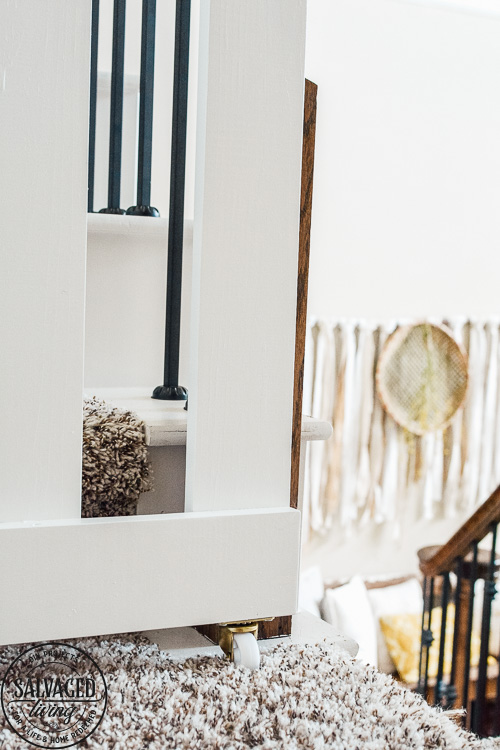 How to build a stylish stairway gate to keep pets or kids out! This easy DIY gate tutorial will look great and blend with your traditional decor. We keep our dog off the carpet with this pet gate. #petgate #stairgate #childproof #DIYpet #cleancarpet #doggate #petgatediy #petgateforstairs