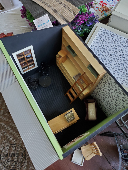 Progress on the creatin' contest miniature garden shed dollhouse. This tiny garden shed is coming along with fun details like a shingled dollhouse roof and upcycled display pieces from old drawers and broken furniture. Miniature crafting is so much fun, join me! #dollhouse #miniatures #gardenshed #miniaturegarden #minitureshop #miniaturecontest #dollhouseDIYideas