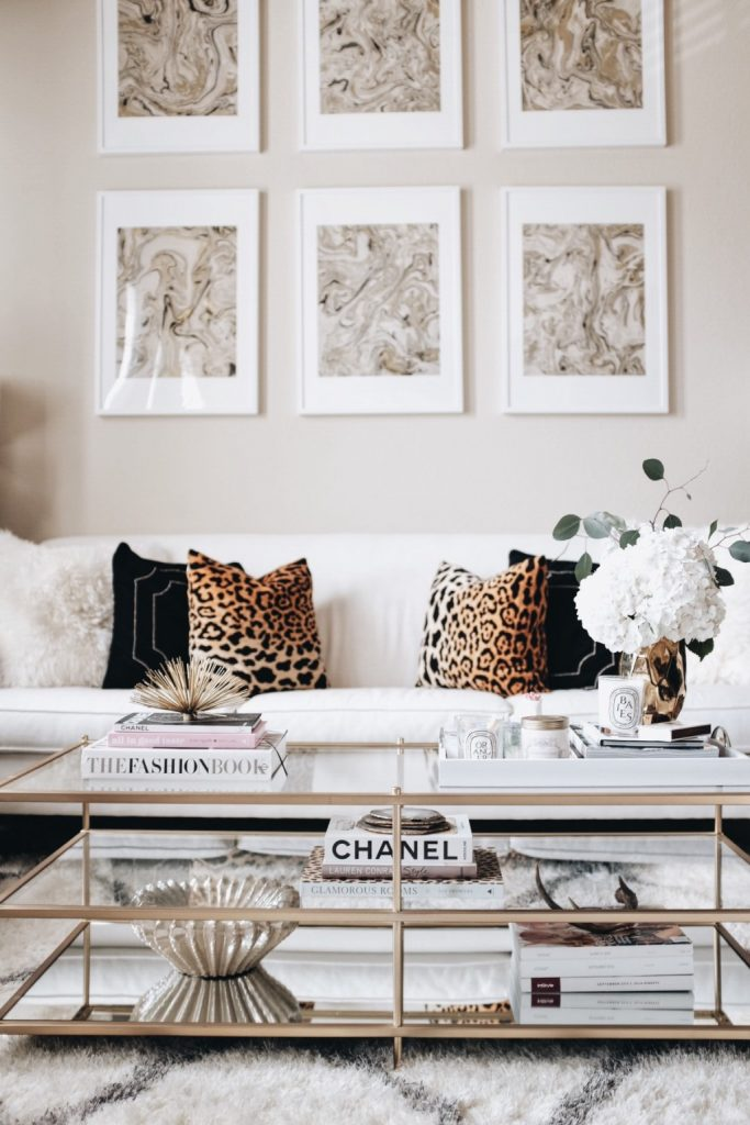 Grab these coffee table decor ideas for a cozy living room. This post is awesome, it has a list of must have elements for cozy coffee table styling plus a list of supply ideas for your cozy coffee table to be magazine worthy! #coffeetablestyle #coffeetabledecor #vignettestyling #decortips #decorating101 #decoratingtips #cozylivingroom #livingroomdecor #coffeetabledecorideas