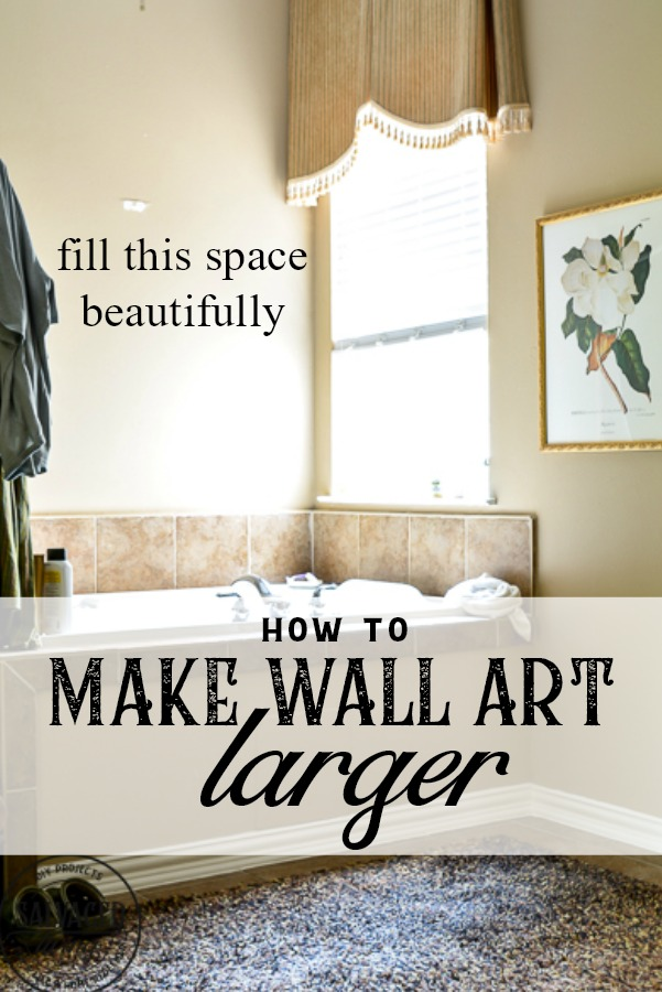 How to make wall art larger. Make sure you fill your walls with the correct scale artwork. This decorating idea will help you use what you have to make artwork that fits your space beautifully. #walart #decoratinghack #decoratingtip #DIYwallart #interiordecorting