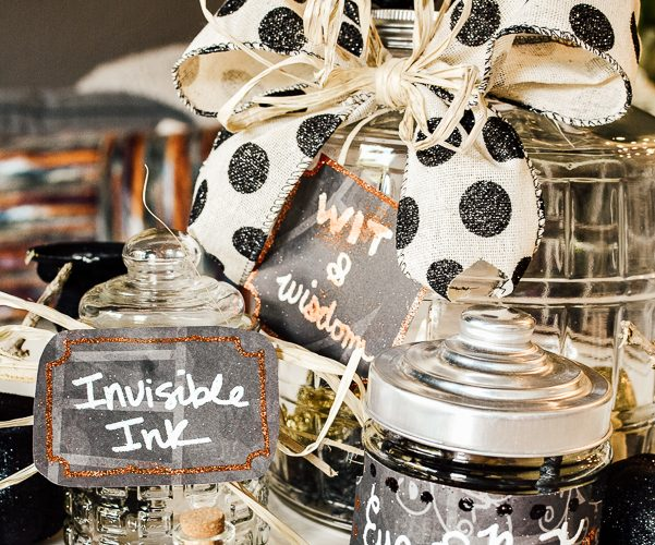 Learn how to emboss labels for Halloween apothecary jars. Learning an embossing technique with a heat tool is great to know for paper crafts, Halloween decor and a variety of crafting ideas. You will love these simple Halloween decorating ideas, many with items from the dollar store. To decorate for Halloween on a budget. #DIY HalloweenDecorations #heattoolprojects #heattoolideas