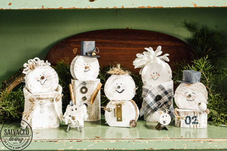Learn how to make a cheap and easy DIY scrap wood snowmen family. The perfect Christmas decoration or gift idea for a family. This easy snowman craft lets you personalize each snowman face and outfit with junk art from your house! #holidaydecor #handandeChristmas ##snowmancrafts #woodensnowmen #farmhouseChristmas