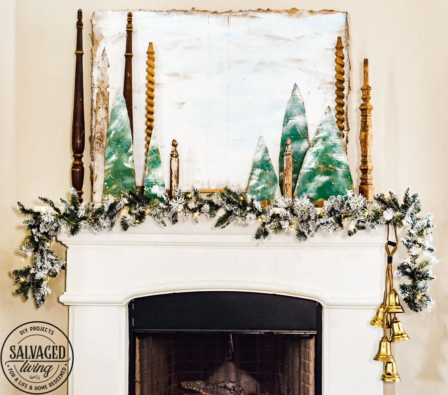 Decorate your mantel with these budget friendly ideas this Christmas! Plus I have a great tip on how to hang garland without nails for damage free decorating! This simple cardboard craft rounds out the Christmas fireplace decorations! #DamageFreeHolidayDecor #CommandDoNoHarm #cardboarddecor #fireplacedecor #vintageChristmas #budgetgarland #easyChristmasdecor