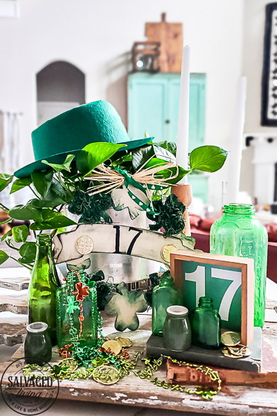 St. Patrick's Day decor ideas from the Dollar store. Use this cute St. Patrick's day wreath tutorial and St. Patrick's Day home decor styling idea to create a cute green space in your home! Mix old, vintage items with dollar store decor for a classic St. Paddy's day look. #stpatricksday #dollarstorecraft #budgetdecoridea