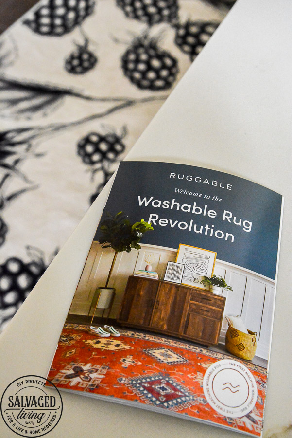 We LOVE our new machine washable rug for the kitchen. This Ruggable Rug in a berry print adds whimsical fun to our kitchen, is stain resistant and stays in place. You can see a video of how our new kitchen rug runner is the best kitchen rug for us on the blog! #kitchenrug #washablerug #affirdablerug