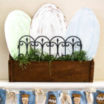 Decorate your mantle for Easter with this budget Easter mantle decorating idea from cardboard! Seriously the best budget decorating hack there is , so easy and you can paint it any color or style. Also tips to make an Easter banner from dollar store items and things you have on hand at home already. #budgetdecor #eastermantle #easterdecoratingideas #dollarstorecraft #dollartreedecor