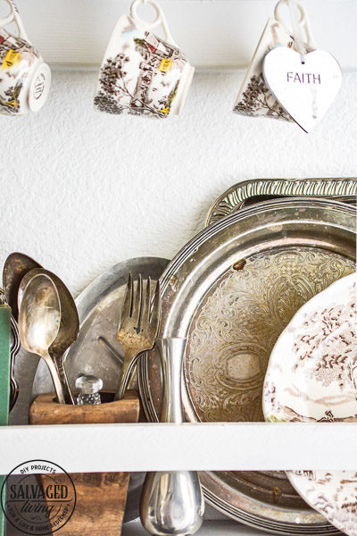 Does you house lack built in charm? Add your own with this diy built in plate rack tutorial. You will learn how to build a wall plate rack and how to decorate a plate rack for vintage style charm and a cozy home. #cozyhome #farmhousekitchen #kitchendisplay #butlerspantry
