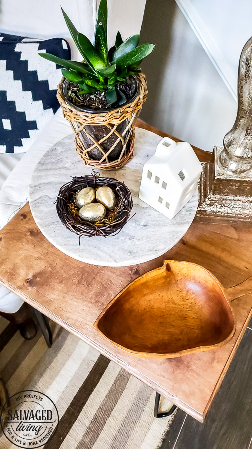 this list is full of amazing ways to decorate with wood bowls. Using wooden bowls in your decor is a great way to add vintage style, warmth, depth and texture to your home decorating. You can find wooden bowls in thrift stores and garage sales then use them in your home decor with this simple decorating ideas! #woodensaladbowl #vintagedecor #cozyhome #decoratingideas