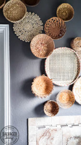 everything you need to know about creating basket gallery wall art. Where to find vintage baskets, how to hang baskets and how to layout a basket gallery wall are all here in this gorgeous gallery wall trend idea. #vintagedecor #wovenbaskets #basketwall #gallerywall