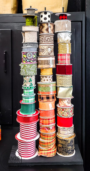 DIY ribbon storage idea to organize your craft room ribbons. This Ribbon storage rack idea is perfect for all the beautiful ribbons taking over your craft space that needs organizing! #ribbonstorage #wreathmaker #diyideas