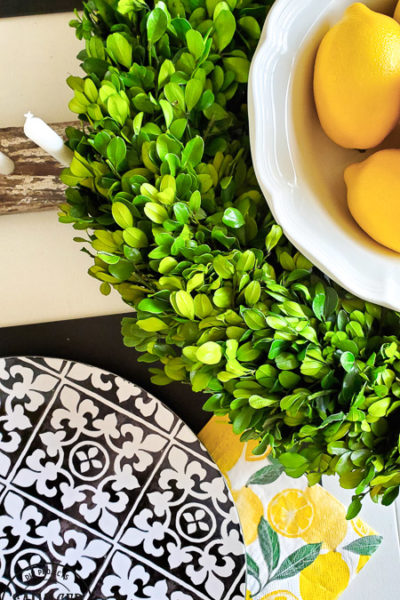 Create an easy DIY centerpiece for your summer tablescape and use it all year round in your home decor. #scrapwood #picketfence #summertable #lemondecor