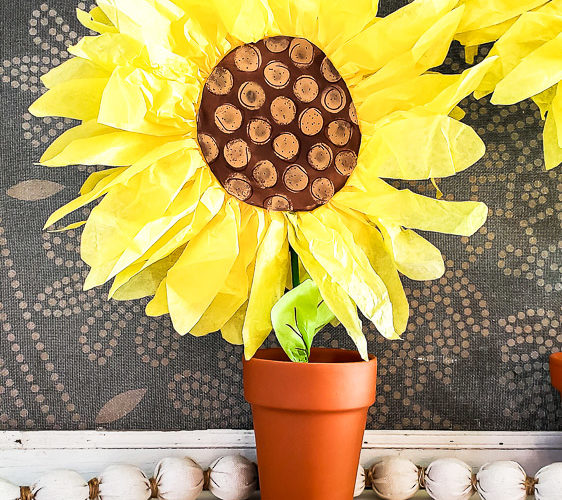 DIY paper sunflowers for home decor mantel idea. Make these giant sunflowers out of tissue paper for your summer mantel decor or make small paper sunflowers for an easy centerpiece idea or vignette styling. #summerdecor #papercraft #budgetdecor