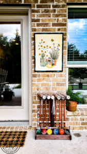 Learn how to hang pictures on brick wall easily with this step by step tutorial. Haning pictures on brick is easy with the right tools and can make your outdoor living space feel like a cozy room in your home. #howtotip #decoratinghack #patiodecoridea