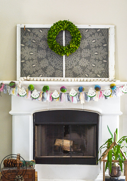 Make this DIY watermelon garland for your summer decor. This budget friendly summer craft is perfect for a summer mantel or summer tablescape! #summerdecor #summercraft #watermelondecor