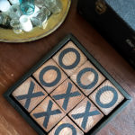 Learn how to make a DIY tic tac toe game from 4 X 4 posts that is so gorgeous you will want to display it, inside or out. This pretty tic tac toe board makes a perfect DIY gift, budget friendly! #tictactoe #woodproject #scrapwood