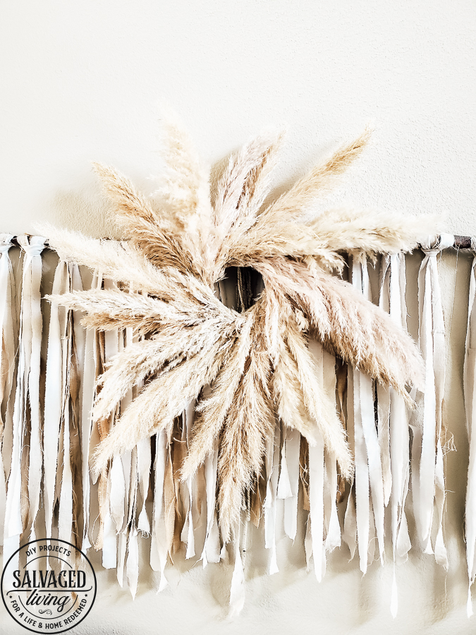 Learn how to make your own Pampas Grass Wreath, this DIY tutorial is easy to follow and perfect for gorgeous fall home decor. A Pampas Grass Wreath adds luxurious beauty to your living room or mantel for a boho chic look that only nature decor can provide! #pampasgrasslivingroom #wreathmaking #wreathtutorial #decoratingwithnature