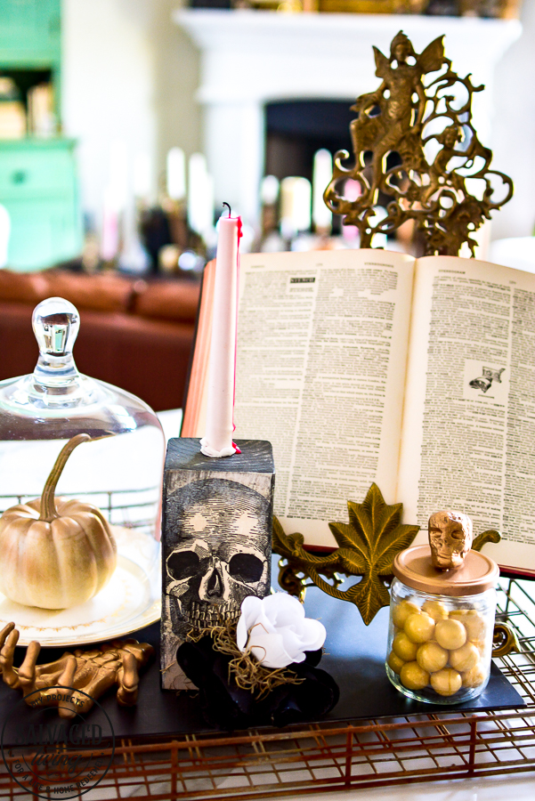 Easy DIY Halloween decor idea that you can craft in minutes. Use this DIY Halloween home decor as a candlestick, shelf sitter, Halloween vignette or table decor idea. Dollar store supplies are perfect for this Halloween idea to make budget friendly Halloween home decorating! #halloweencraft #Halloweenvignette #dollarstorehalloween