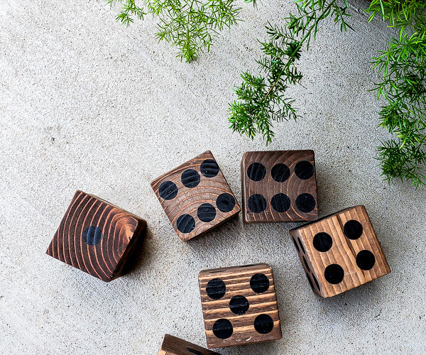Learn how to make the perfect lawn dice for your outdoor game collection. #gamenight #scrapwood #diygames #outdoorideas