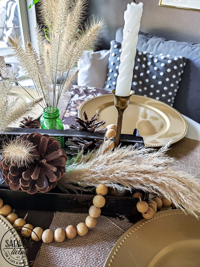 Rustic fall centerpiece idea for your fall decorating on a budget. Use nature and thrifted finds in your fall decor line up for a worn. warm, cozy fall vibe. #fallbudgetdecor #decoratinideas #cozyfall #simplefalldecor