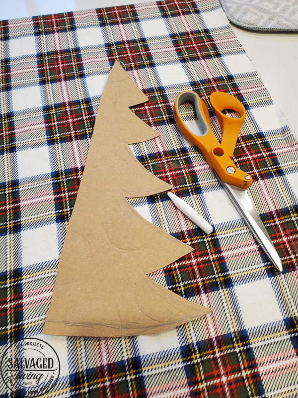 These DIY stuffed fabric Christmas trees make adorable, affordable Christmas decor, the perfect no sew Christmas fabric project! Pick your favorite holiday fabric and make a set of fabric Christmas trees to decorate any holiday vignette with. They are an awesome DIY Christmas gift too! #fabricChristmasornaments #fabricChristmascrafts #scrapfabricproject #DIYChristmas #Treecraft
