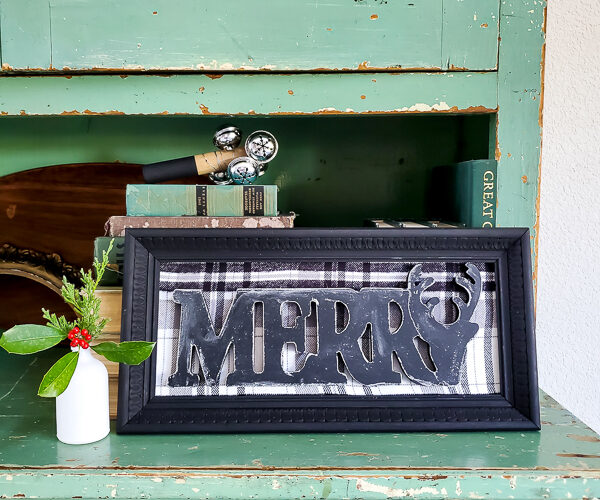 Make a dollar store Christmas sign in no time that looks like gorgeous farmhouse CHristmas decor. This simple dollar tree craft uses an old picture frame to mix old and new for gorgeous dollar store home decor for Christmas. #dollartreecraft #dollartreechristmas #dollarstoreholiday #budgetChristmasdecor #framemakeover