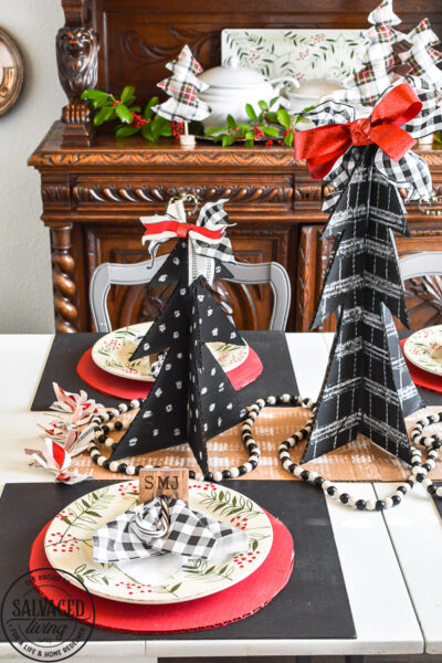 Amazing budget friendly Christmas decorating ideas including a chalkboard Christmas tree made out of cardboard. Cardboard craft ideas to use in your holiday decorating that are so adorable, like a glittery plate charger, ribbon table runner and more ideas to try. #buffalocheck #chalkboardcraft #DIYChristmas #cardboardcraft