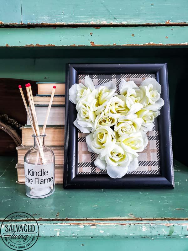 Use dollar store rose for Valentine's Day artwork with this simple DIY Valentine's Day decorating idea. #dollartree #valentinesdayart #valentinecraft