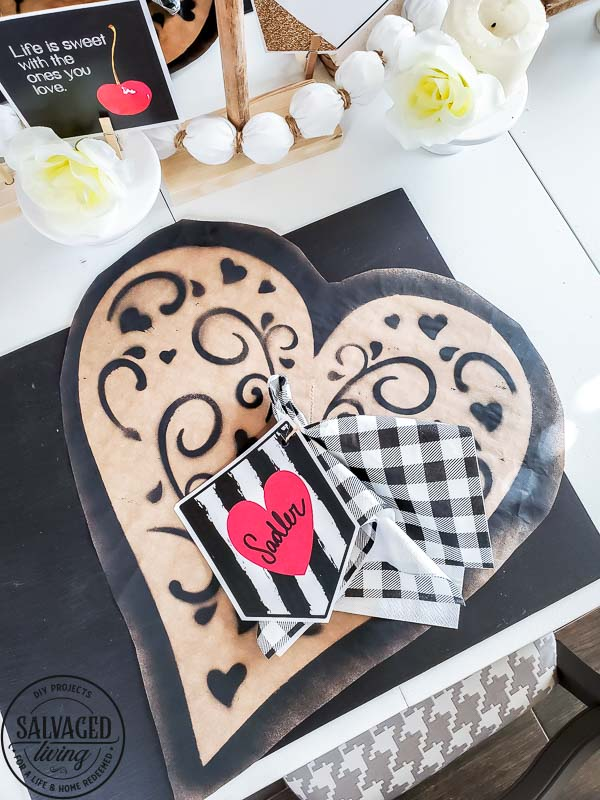 Grab some decorating ideas for your Valentine's Day table here. Paper crafting with dollar store supplies is the perfect budget friendly Valentine's Day decor you need to set a table for a crew or a table for two. Thes romantic paper hearts are a gorgeous Valentine's centerpiece idea. And these paper placemats are a simple Valentine craft to add to your holiday table.