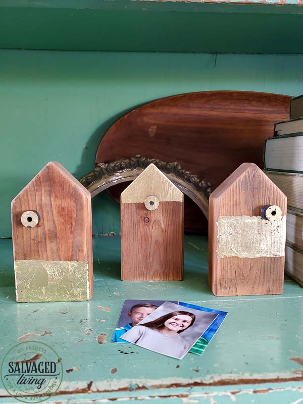 Make your own scrap wood picture holder house with this easy DIY that takes home made up anotch with gold leaf gilding for a modern touch on rustic charm for a great way to display kid's school pictures in style! #schoolpicture #scrapwoodproject #pictureframeidea #goldleafproject