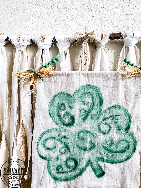 Use a dollar store felt shamrock for an easy St. Patrick's Day craft - this St. Paddy's Day banner is a beautiful watercolor shamrock idea you can DIY to decorate for St. Patrick's Day! #StPatricksDaydecor