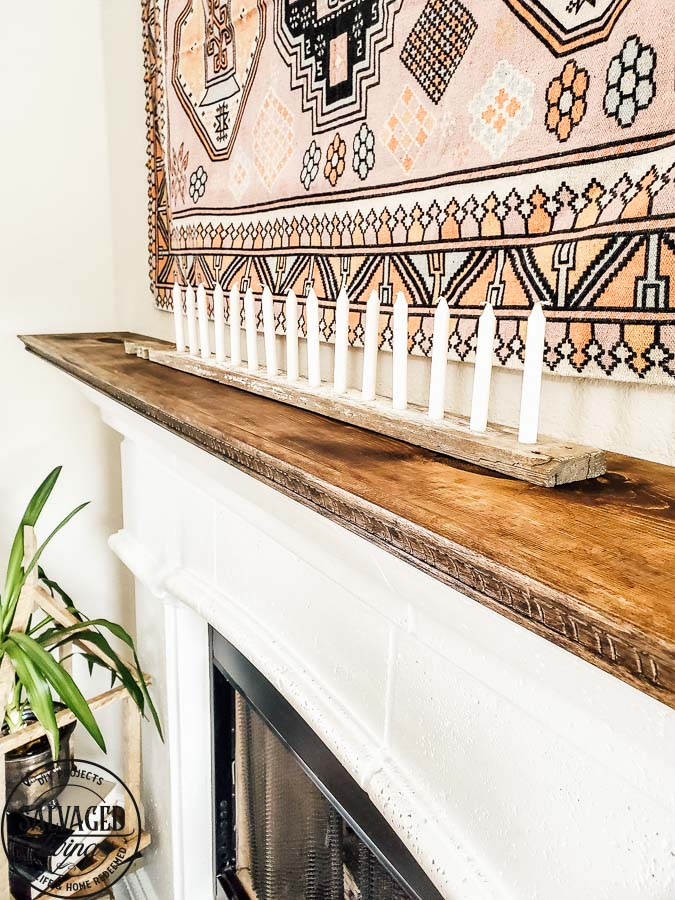 See how to make a stone fireplace mantel into a wood fireplace mantel. This DIY mantel idea is perfect for the person who loves to decorate their mantel but struggles with how to hang deocr on stone mantel or concrete mantel. It is an easy fireplace fix for a more functional fireplace mantel. #woodmantel #DIYmantel #manteldecor #stonefireplaceidea
