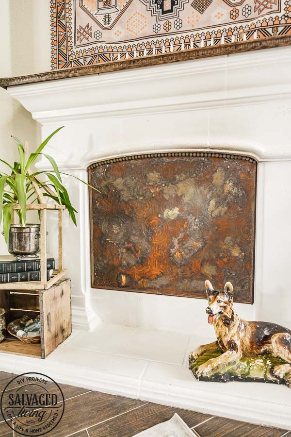 Learn how to make a custom fireplace insert to cover your fireplace opening when you aren't using it for fire. I will show you how to make almost any surface rusty for a vintage fireplace insert that is custom fit to your hearth. This stunning DIY decor project looks so high end and vintage, you will love it. #modernmasters #modernmastersmetaleffects #metaleffects #fireplacedecor #interiordecor #springrefresh #oxidizedfinish #sponsored