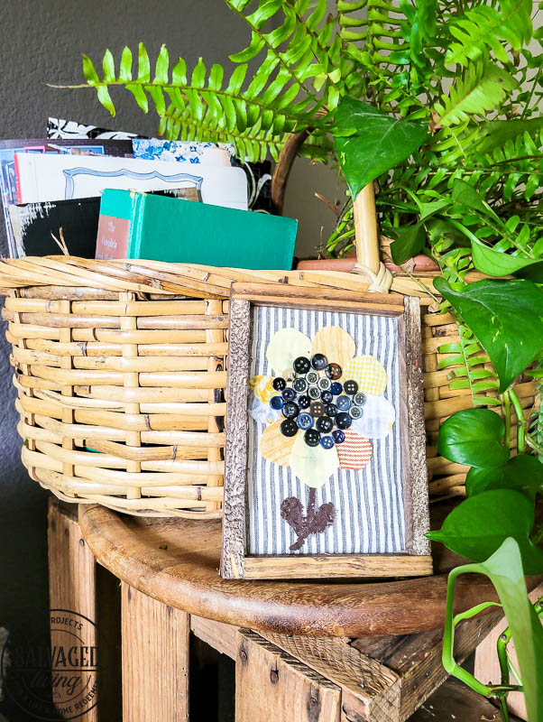 completed DIY sunflower art framed on table next to basket