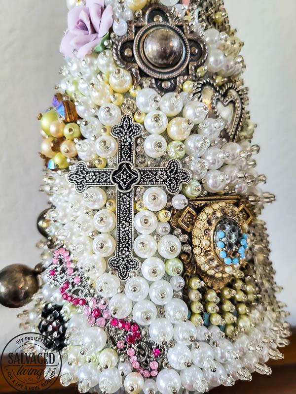 cross on vintage jewelry tree