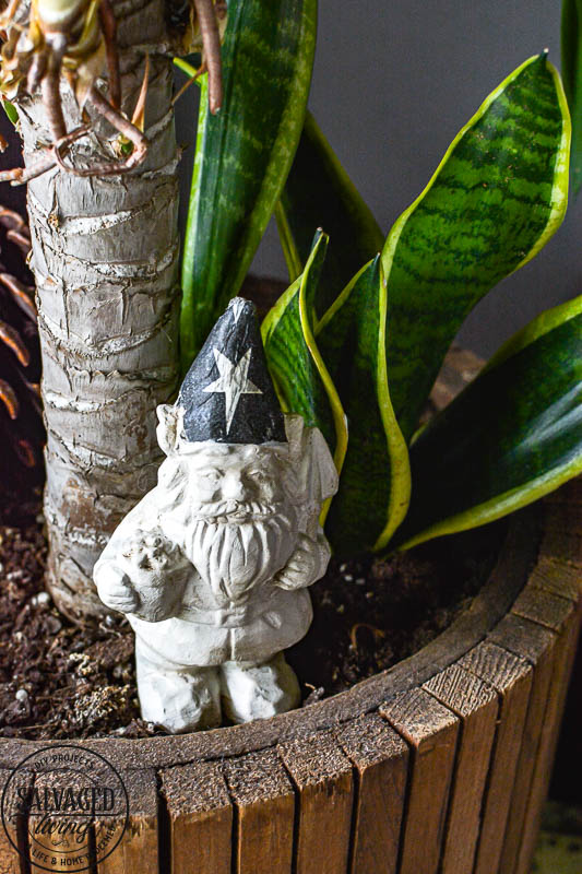 Dollar Store Gnome Makeover in front of tree