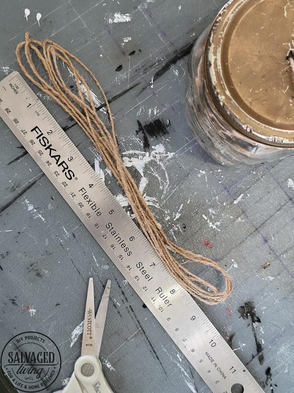 How to make DIY wood bead napkin holders for farmhouse style table settings and budget entertaining. #tablescape #woodbeadidea #vintagestyle #neutraldecor
