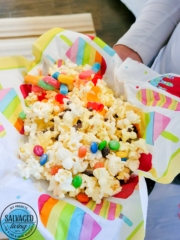 Get a free print out shopping list of the most amazing toppings for a gourmet popcorn bar. A popcorn bar is perfect for entertaining a crowd, it covers all the bases - salty, sweet, savory and sour. I have a list of the perfect popcorn bar ideas for you here! #popcron #crowdpleaser