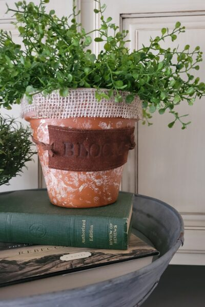 heat stamped old belt upcycle tag on planter