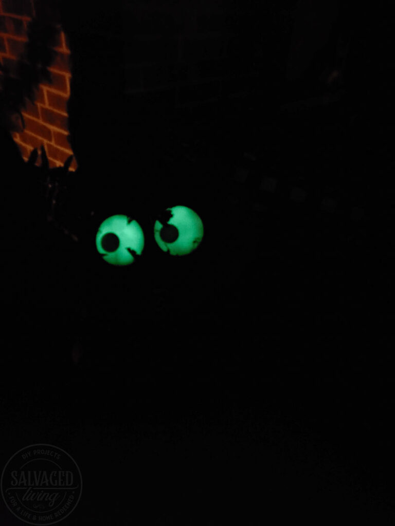 Create a spooky porch for Halloween with DIY glow-in-the-dark outdoor Halloween decor. Perfect for your plants and yard, these glow in the dark eyes bring your outdoor decorating to life! #rustoleum #rustoleumimagine #glowinthedark #halloween #halloweendecor #sponsored #outdoordecor #DIYHalloweencraft