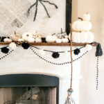 Three Halloween craft ideas to bring your Halloween mantel to life on a budget. These Halloween decor ideas are perfect for the crafty, budget friendly decorator to have a neautral farmhouse style Halloween decor that won't break the bank! Make a paper spider web, newspaper pumpkins and a precious witch's broom. #halloweenDIY #budgetHalloween #Halloweenpapercrafts