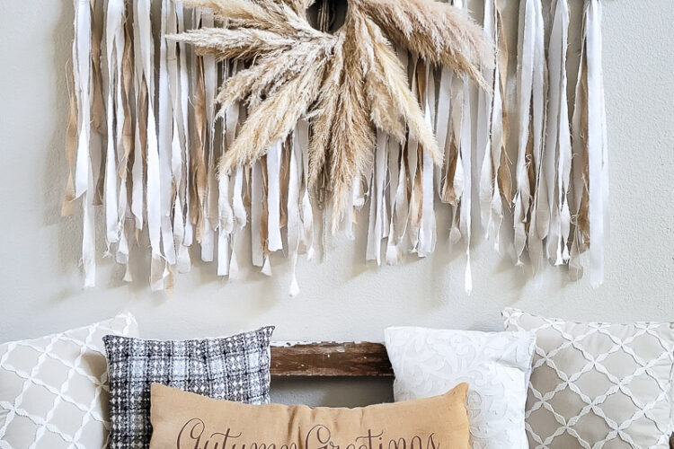 Learn how to make the large scale wall hanging I use in my living room. This shabby chic wall art is perfect fora large space or make it small and DIY this idea to fit your needs. Using an old sheet, burlap and drop cloth you can create a boho wall hanging in no time. #dropclothcraft #walldecor #wallartideas #DIYbohodecor